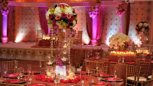 Indoor wedding venue with table settings